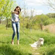 Woman out walking her dog and pointing — Stock Photo