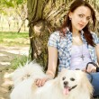 Beautiful young woman with her little dog — Stock Photo
