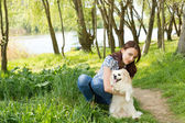 Pretty girl posing her cute little dog — Stock Photo