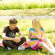 Young friends enjoy a healthy picnic - Stock Photo