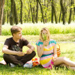 Cute young couple having food on picnic — Stock Photo #25082563