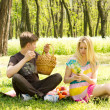 Couple having a picnic date, sitting on the grass — Stock Photo #25082575