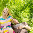 Royalty-Free Stock Photo: Attractive couple lying down on the grass
