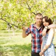 Couple in love posing with the tree — Stock Photo