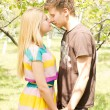 A young couple romancing on a picnic date — Stock Photo