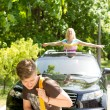 Man towing a car after a breakdown — Stock Photo