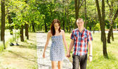 Young couple walking together in a park — Stock Photo