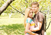 Romantic young couple in the park — Stock Photo