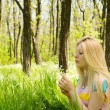 Young Woman Blowing Dandelion Seeds — Stock Photo