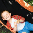 Laughing little boy in a hammock — Stock Photo