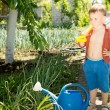 Youngster helping out in the veggie garden — Stock Photo