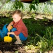 Stock Photo: Boy digging in vegetable patch