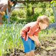 Little boy working with his mother in the garden — Stock Photo #25364865