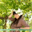 Stock Photo: Pretty woman with flowers in her hair
