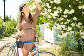 Woman picking spring blossom — Stock Photo