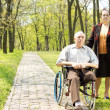 Royalty-Free Stock Photo: Handicapped elderly man with his wife