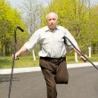 Постер, плакат: Elderly disabled man balancing on one leg
