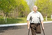 Elderly male amputee — Stock Photo