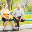 Man and woman in the park — Stock Photo