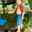 Young boy playing in the garden — Foto de Stock