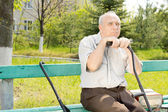 Old man outdoors — Stock Photo