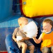 Happy young boys sharing a large cotton-candy ball — Stock Photo #26144399