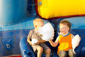 Happy young boys sharing a large cotton-candy ball — Stock Photo