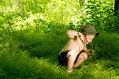 Playful small boy discovering nature — Stock Photo