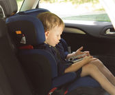 Little boy amusing himself in a car — Stock Photo
