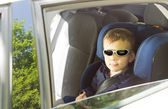 Cool little boy in sunglasses — Stock Photo