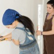 Woman DIY drawing a straight line on a wall — Stock Photo
