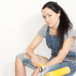 Serious woman with a paint roller — Stock Photo
