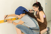 Two female friends doing DIY at home — Stock Photo