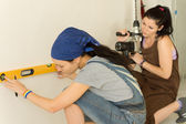 Two women doing home renovations — Stock Photo