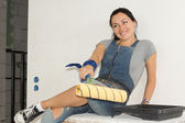 Laughing woman with a paint roller — Stock Photo