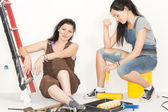 Two happy women taking a break from decorating — Stock Photo