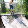 Stock Photo: Teenage girl on roller skating ramp