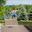 Agile young female roller skater — Stockfoto