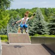 Стоковое фото: Agile young female roller skater