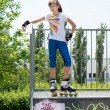 Teenaged roller skater posing on a ramp — Stock Photo