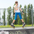 Young girl in rollerblades on a ramp — Stock Photo