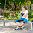 Attractive young girl in rollerblades — Stock Photo