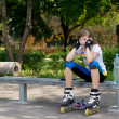 Young roller skater taking a rest — Stock Photo