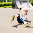 Young rollerblader takes tumble — Stock Photo #27638821