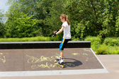 Young girl roller skating in the park — Stock Photo