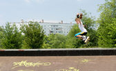 Young teenager jumping on her rollerblades — Stock Photo