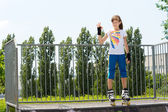 Young roller skater giving a Perfect gesture — Stock Photo