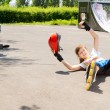 Stock Photo: Teenage girl falling while roller skating