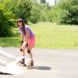 Stock Photo: Young girl roller skating on ramp