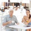 Elderly father taking his daughter out for lunch — Stock Photo